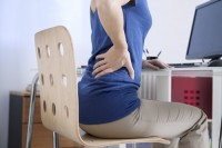 Should I tell my employer that I have back pain?